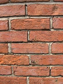 220px-Brick_wall_old